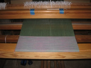 Space dyed weft and green warp. Looking pretty.